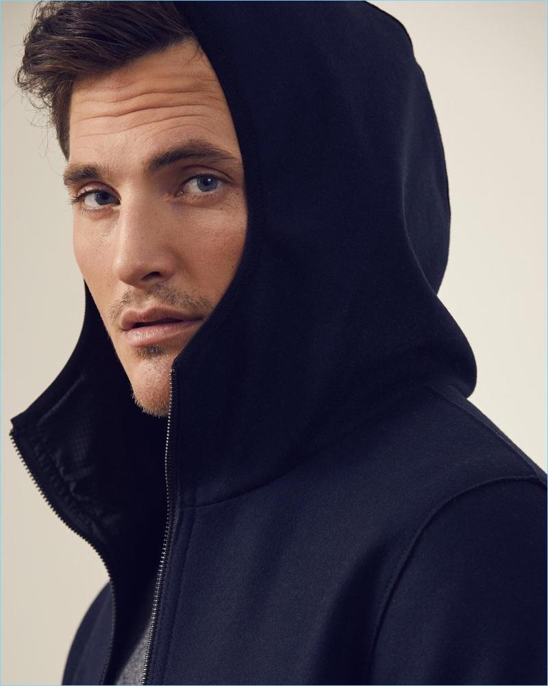 Ollie Edwards dons an Italian wool-blend knit hooded jacket by Banana Republic.