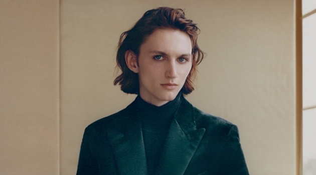 Henry Rausch dons a velvet tuxedo jacket and a wool-blend turtleneck sweater by Brioni.