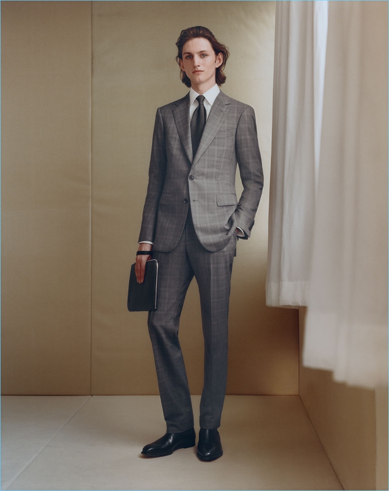 Front and center, Henry Rausch dons a plaid wool two-button suit by Cifonelli.