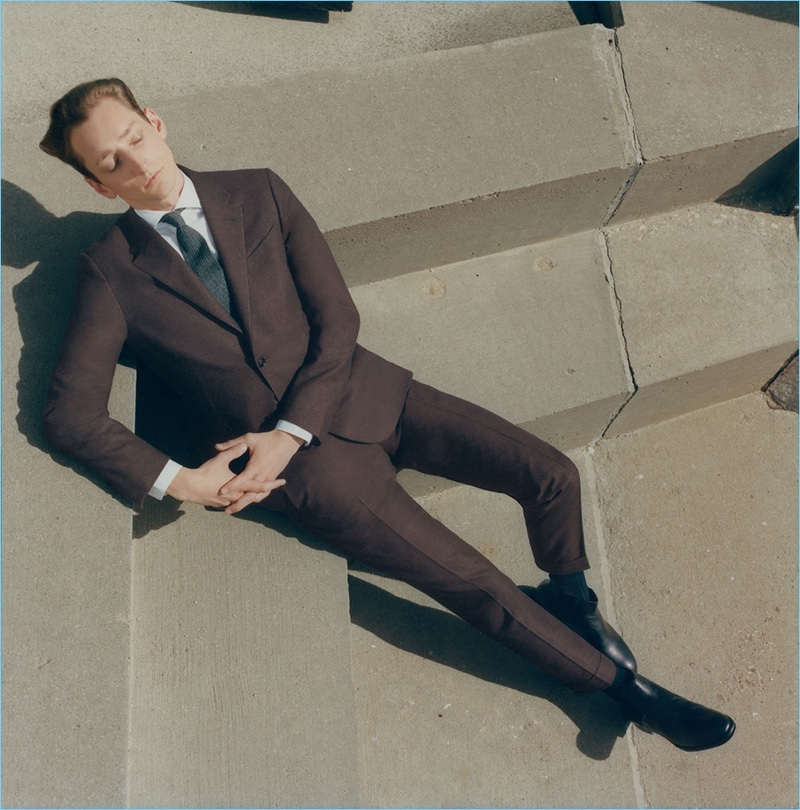 Tom Gaskin steals a moment in an Ermenegildo Zegna wool two-button suit.