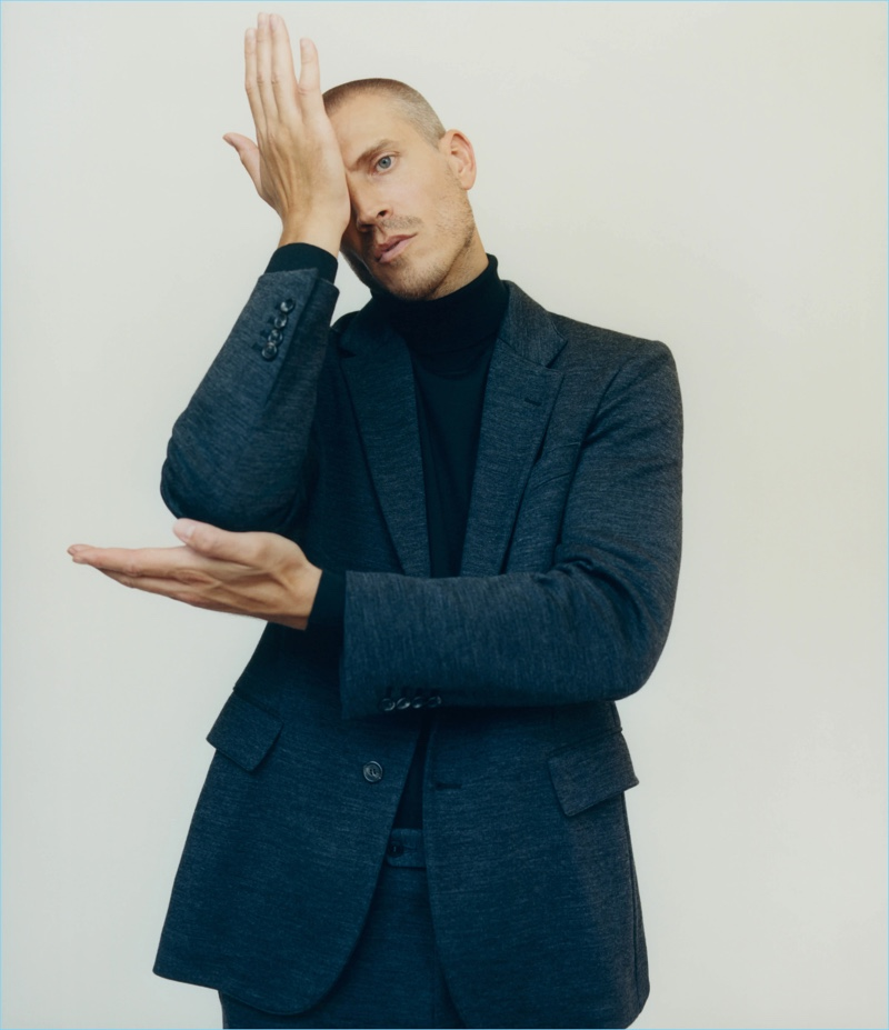 Mike Guenther dons a Brioni wool jersey two-button suit and wool-blend turtleneck.