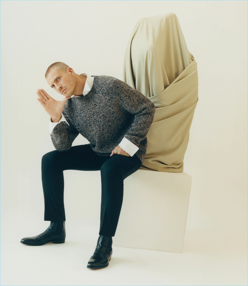 Connecting with Barneys, Mike Guenther wears a Brioni mélange wool chunky sweater and wool flat-front trousers with Crockett & Jones Chelsea boots.
