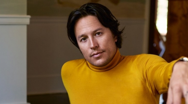 Cary Fukunaga dons a yellow turtleneck from Z Zegna with Sandro pants and a Tom Ford belt.