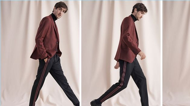 Hamilton Seguin wears a burgundy wool flannel blazer, varsity tape pants, and a coverlock turtleneck from Club Monaco. He also dons Wings + Horns Officer shoes.