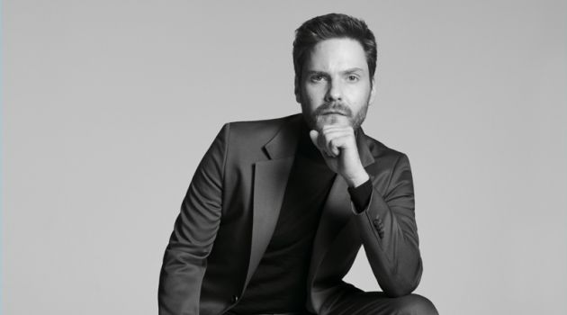 Donning a sharply tailored suit, Daniel Brühl fronts the BOSS Made in Germany capsule collection campaign.