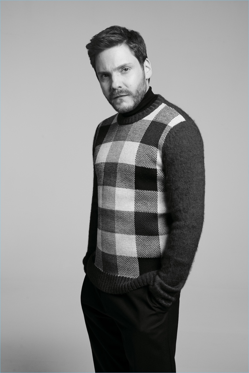 Sporting a check sweater, Daniel Brühl fronts the BOSS Made in Germany capsule collection campaign.