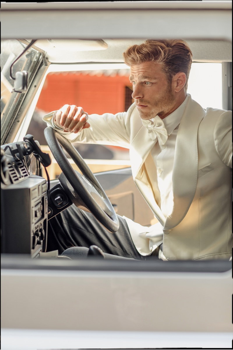 Getting behind the wheel, David Frampton wears a white tuxedo jacket look from Helen Anthony.