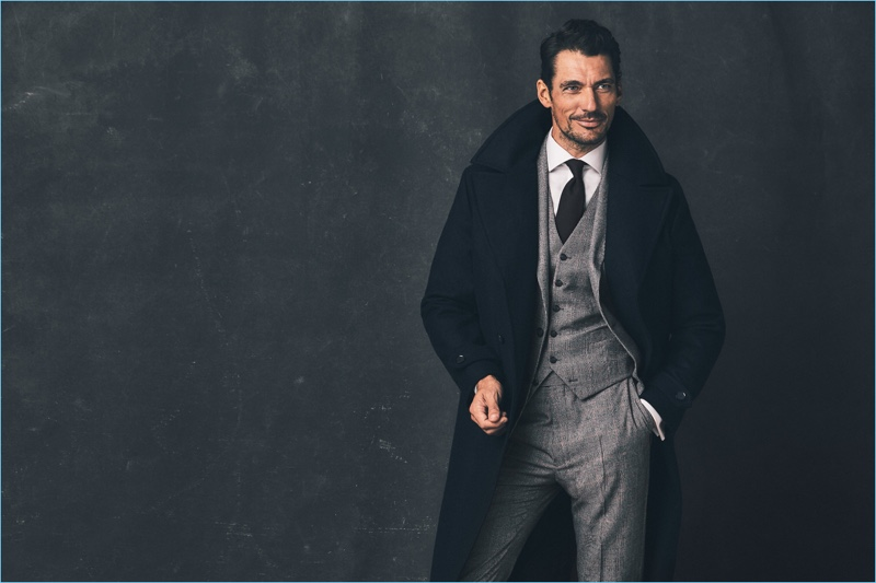 Donning a sharp wool overcoat, David Gandy is dashing in a three-piece suit from his Savile Row Inspired Marks & Spencer collaboration.