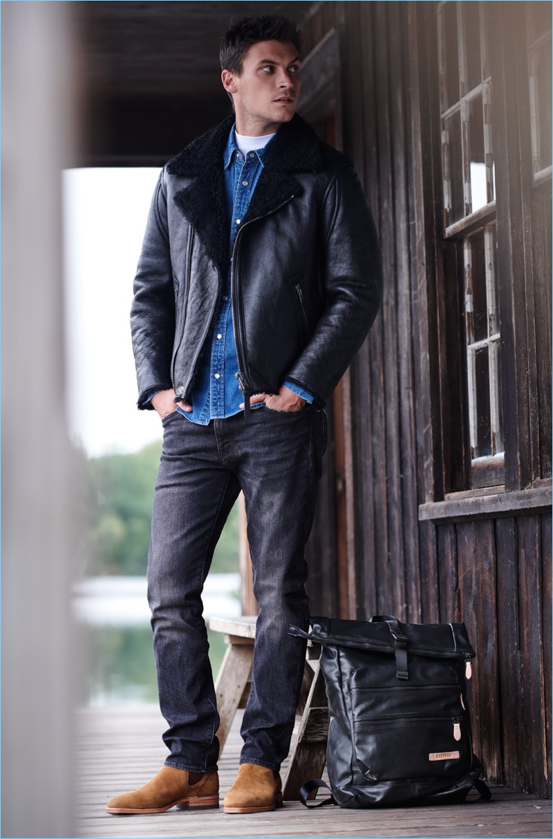 Layer Better: Miles Garber wears a Coach 1941 western shirt and shearling moto jacket. He also sports a Theory mock tee, Levi's Red Tab 511 slim jeans, and an Eastpak Jacker backpack.