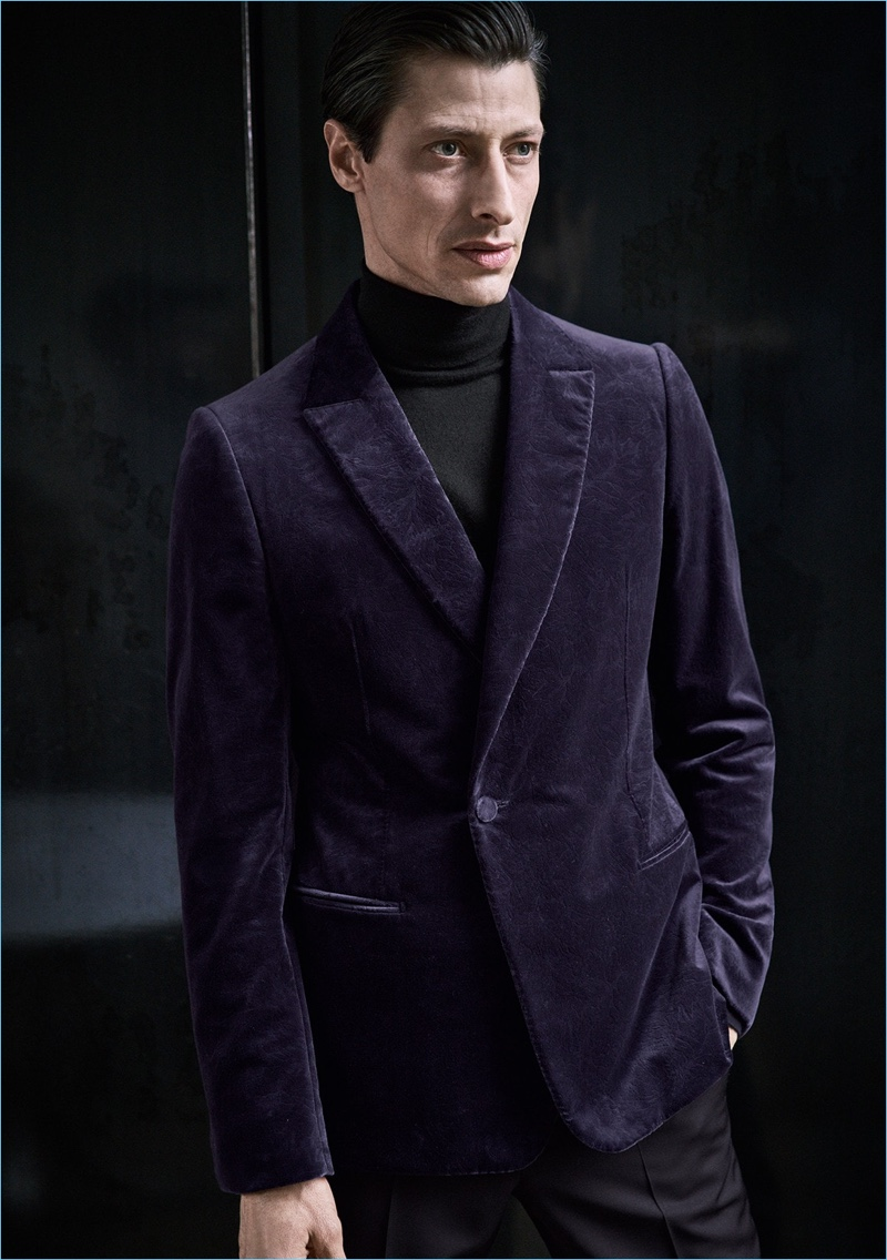 Jonas Mason sports a purple velvet jacket by Ermenegildo Zegna.