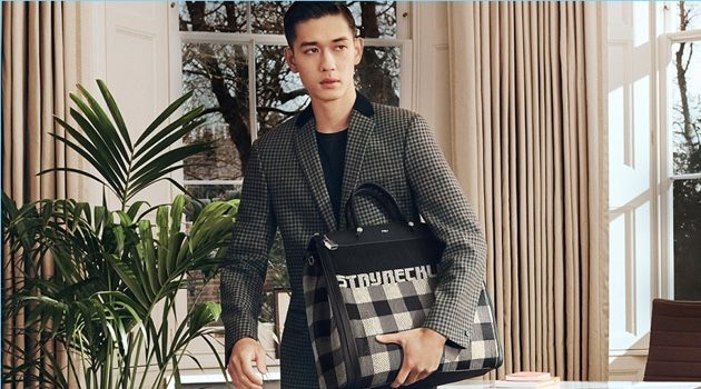 Keisuke Asano takes hold of Furla's Mercurio Tartan bag for its fall-winter 2018 campaign.