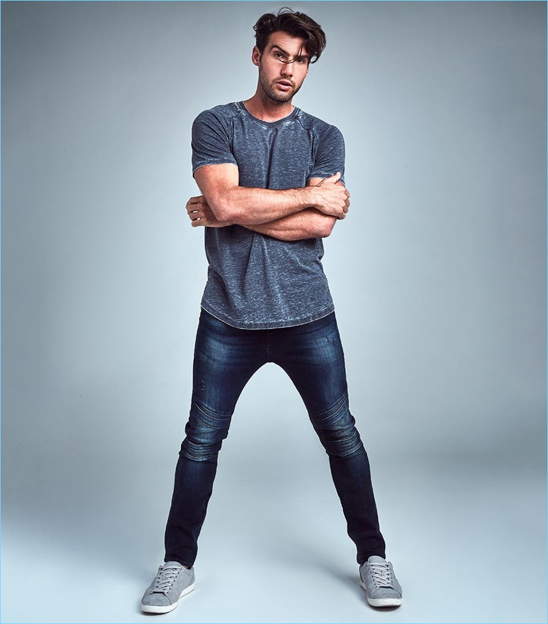 Mitchell Wick rocks skinny-fit jeans from GUESS.