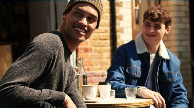 Left: All smiles, Cameron Gentry wears a H&M raglan-sleeved sweater and jeans. Right: Adrien Sahores wears a denim trucker jacket and joggers.