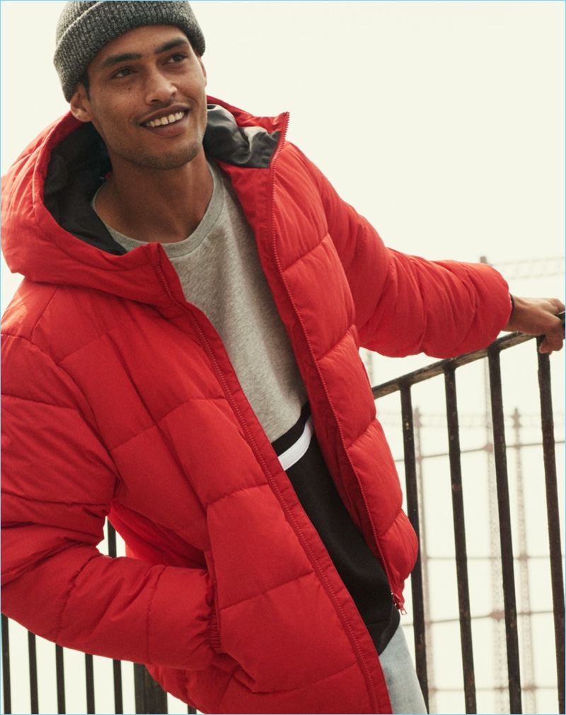 Cameron Gentry rocks a red padded jacket from H&M.