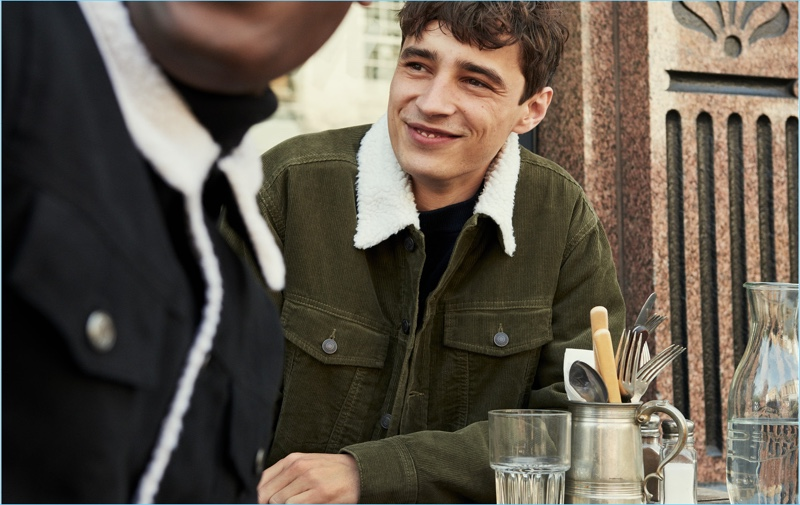 Adrien Sahores sports an olive green corduroy trucker jacket by H&M.