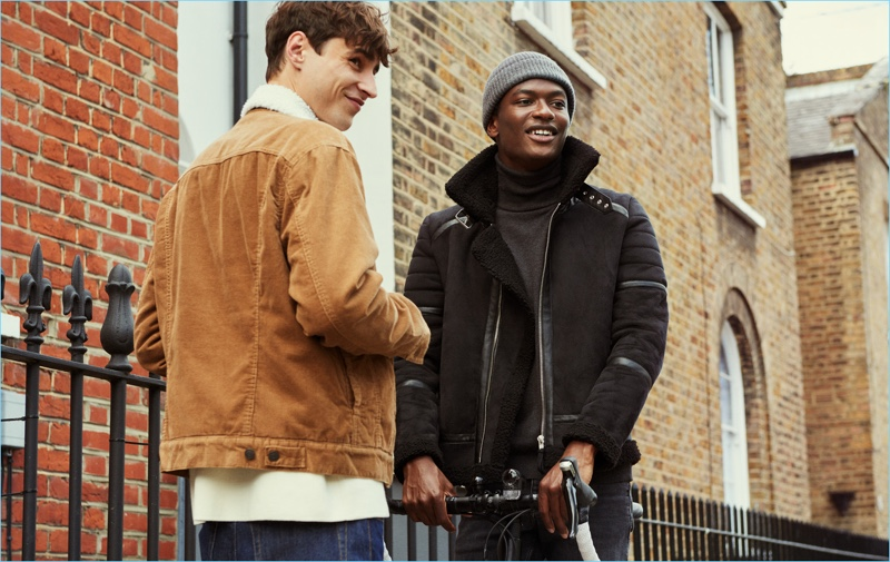 Pictured left, Adrien Sahores dons H&M's felted jacket. Meanwhile, Hamid Onifade wears the brand's biker jacket.