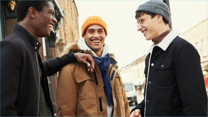 All smiles, Hamid Onifade, Cameron Gentry, and Adrien Sahores don winter outerwear from H&M.