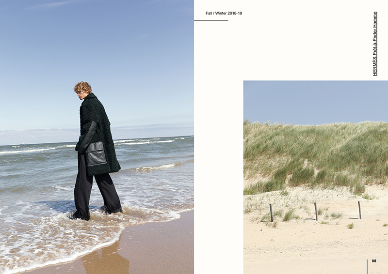 Donning a statement coat from Hermès, Mats Engel takes to the beach.