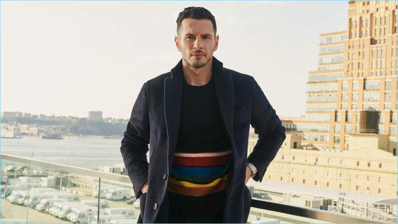 JJ Redick wears a Brioni overcoat, Prada sweater, and Officine Generale trousers with a Vacheron Constantin watch.
