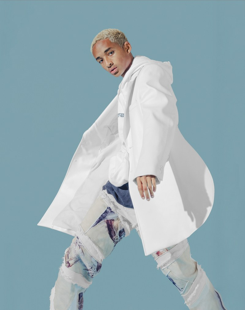 Jaden Smith dons a Comme des Garçons Homme Plus coat with a MSFTS hoodie. He also sports a t-shirt and jeans from his G-Star Raw Forces of Nature collaboration.
