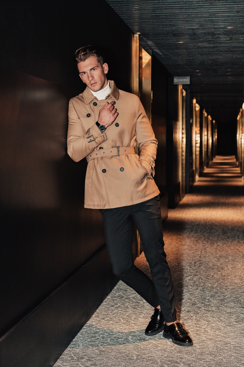 Jake wears trench Burberry, turtleneck Reserved, pants Dior Homme, and shoes Topman.