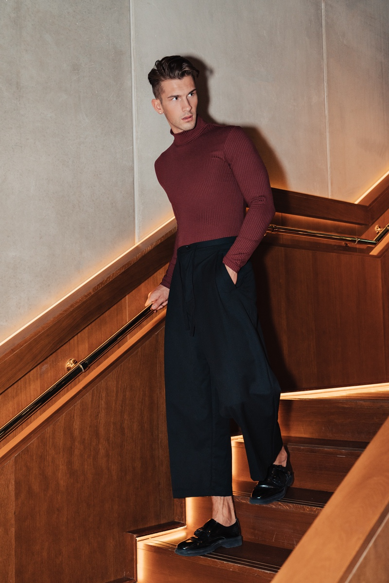 Jake wears turtleneck Reserved and pants Y-3.