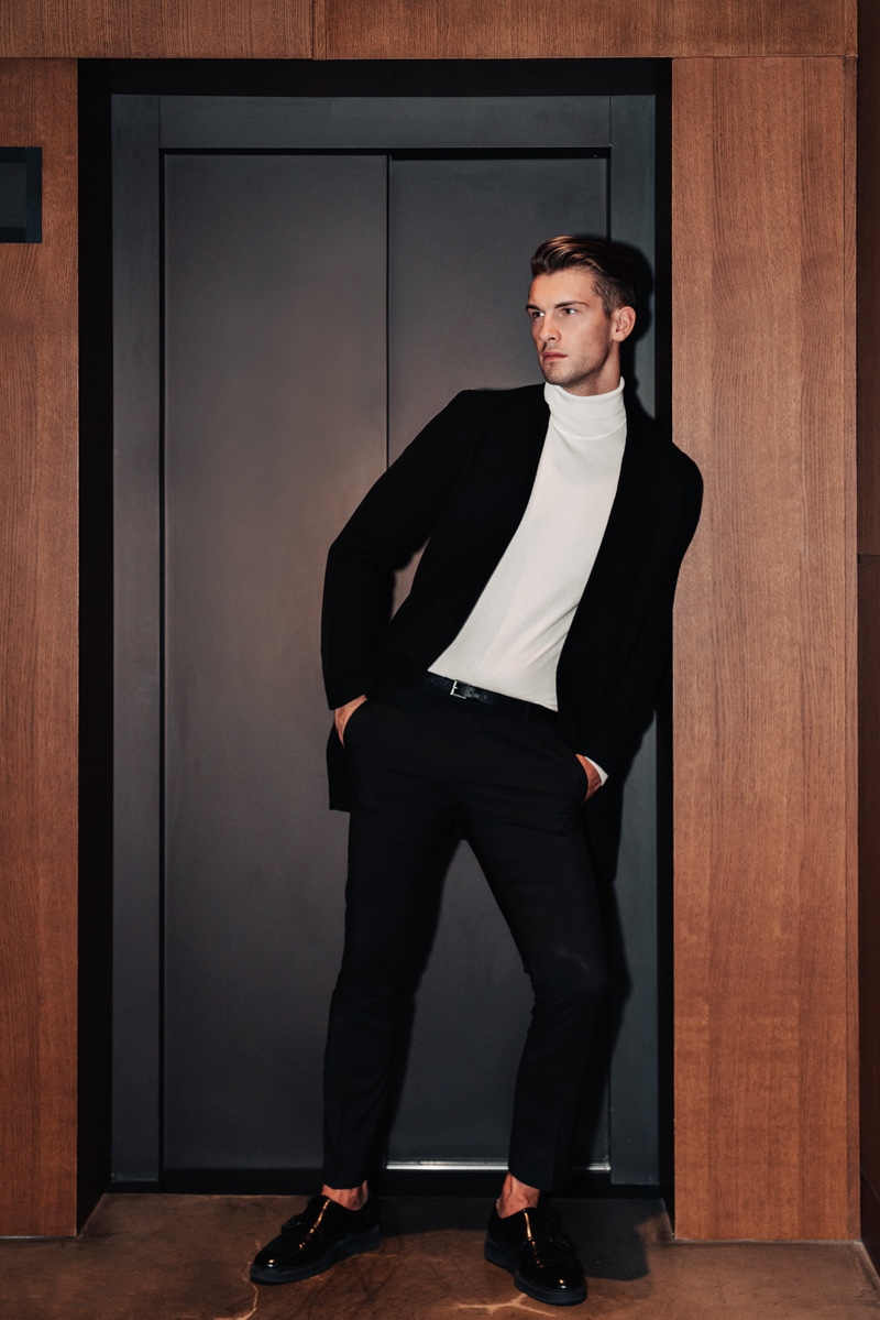 Jake wears jacket Theory, turtleneck Reserved, pants Gucci, and belt ASOS.