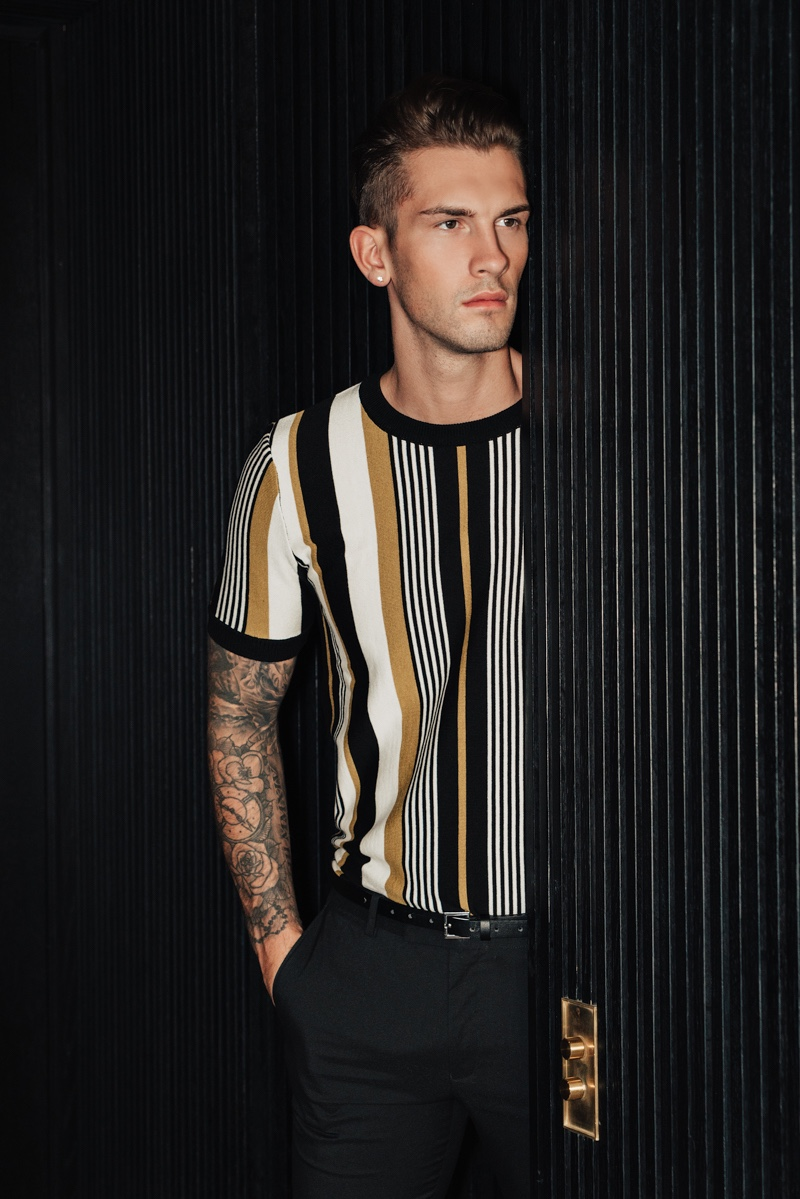 Jake wears striped t-shirt Topman and pants Dior Homme.