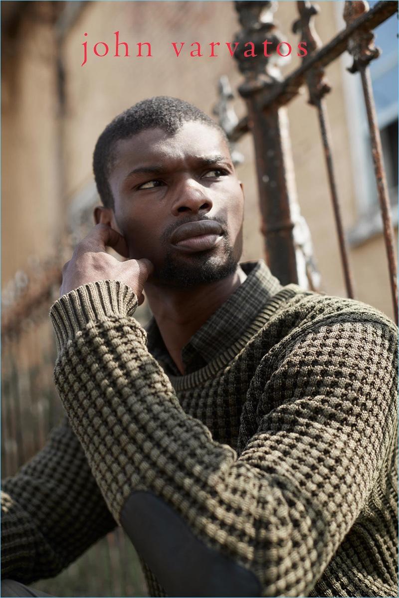Salieu Jalloh dons fall knitwear by John Varvatos Star USA.