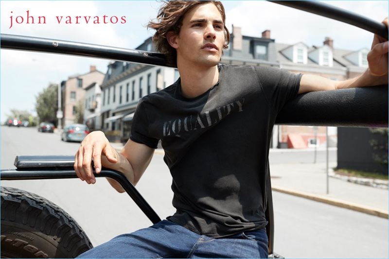 Gordon Winarick sports a t-shirt and jeans by John Varvatos Star USA.