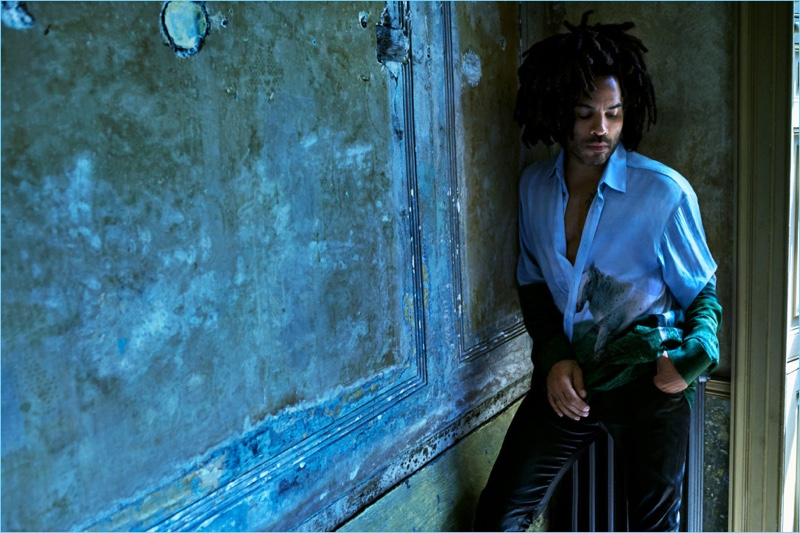 Posing for a moody image, Lenny Kravitz sports a Triple RRR shirt with his own trousers.