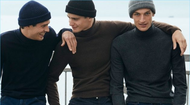 Models Arthur Gosse, Ben Allen, and Aaron Shandel don knit beanies and wool/cashmere turtleneck sweaters by Massimo Dutti.