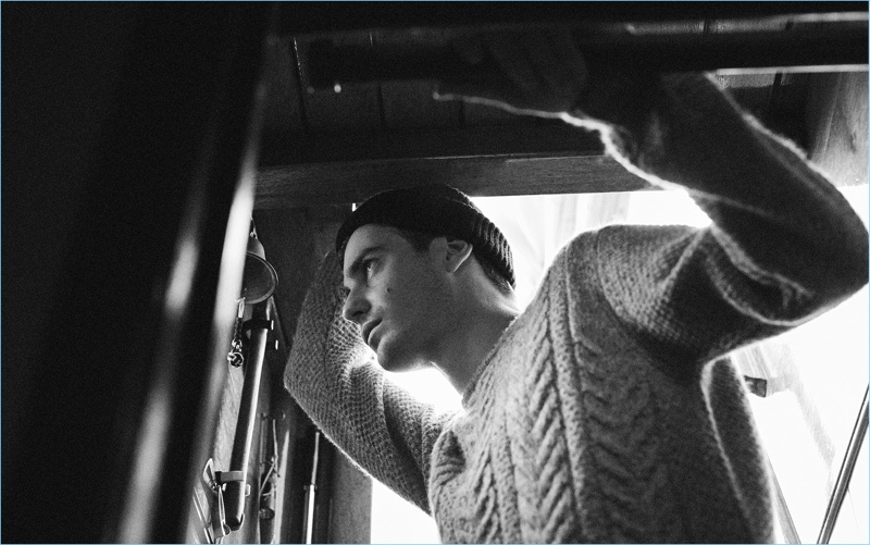 Ben Allen dons a cable-knit sweater and knit beanie from Massimo Dutti.