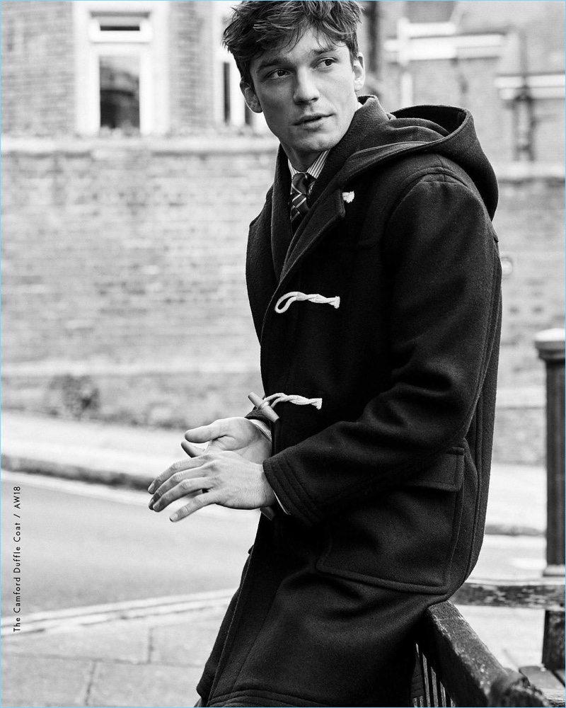 Alexis Petit dons a duffle coat for Morris Stockholm's fall-winter 2018 campaign.