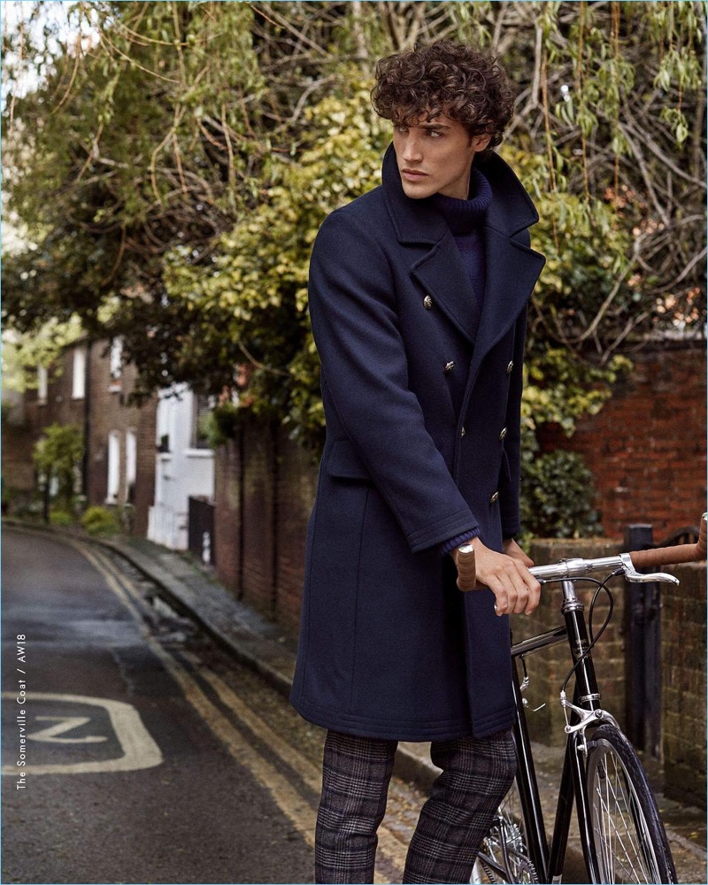 Donning a navy coat, Federico Novello fronts Morris Stockholm's fall-winter 2018 campaign.