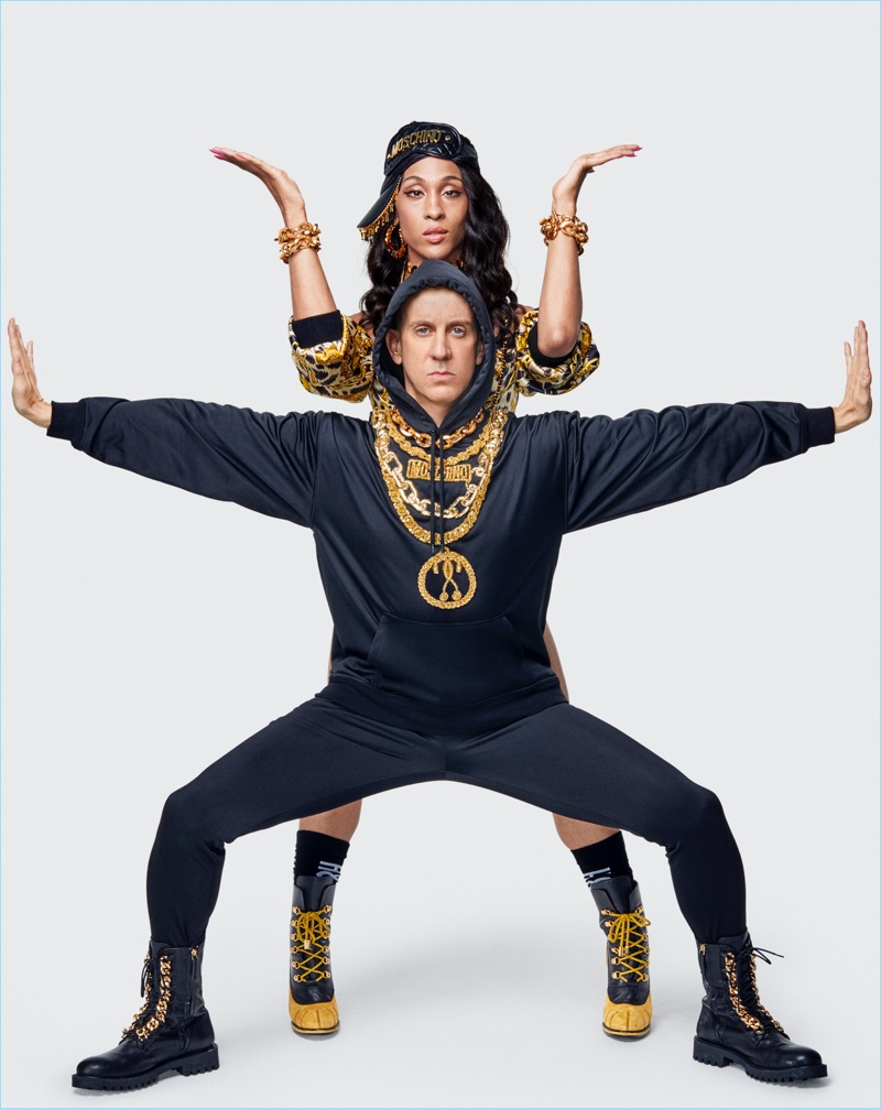 Jeremy Scott and Mj Rodriguez wear fashions from the Moschino [tv] H&M collection.