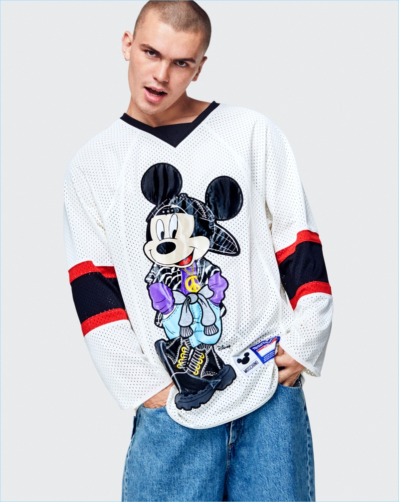Louis Bubko wears a Mickey Mouse jersey from the Moschino [tv] H&M collection.