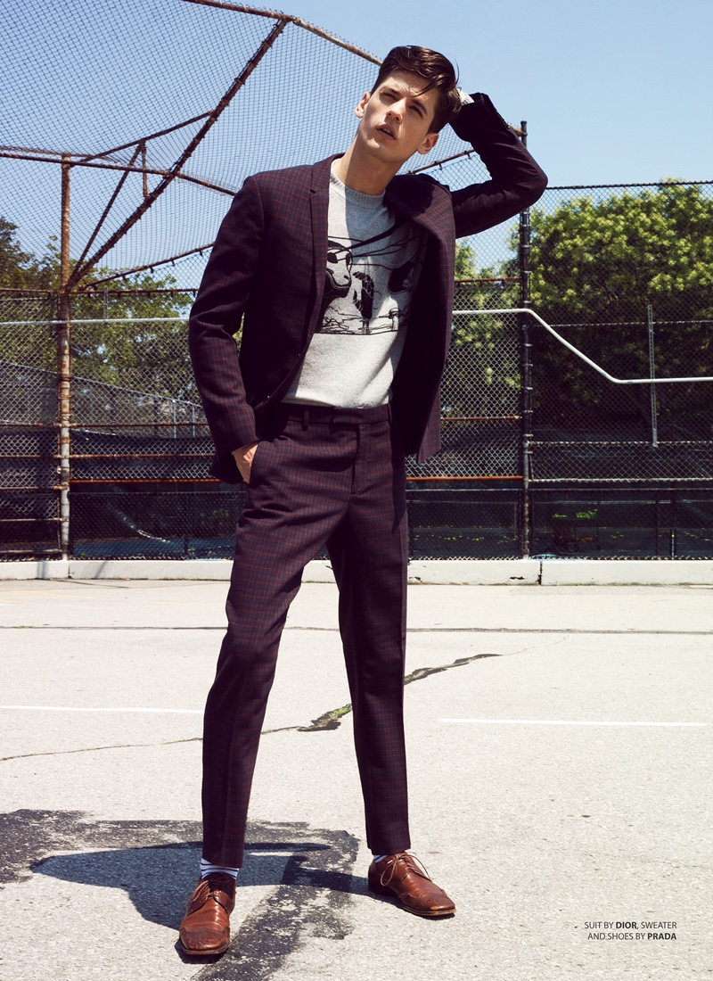 Nate wears suit Dior Men, sweater and shoes Prada.