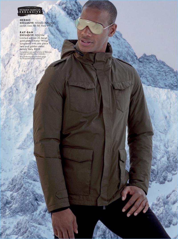 Ready for winter, Sacha M'Baye wears a Herno jacket and Ray-Ban sunglasses.
