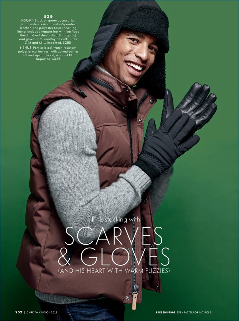 All smiles, Malik Lindo sports a UGG gloves and a hood.
