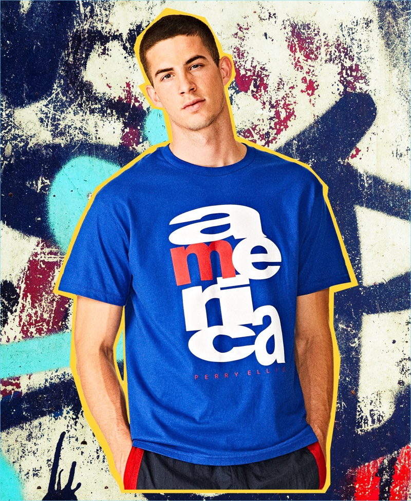 Model Keegan Rodriguez wears a graphic blue t-shirt from the Perry Ellis America capsule collection.