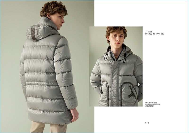 Prepared for the cold, Max Barczak models a light grey down jacket from Peuterey's fall-winter 2018 collection.