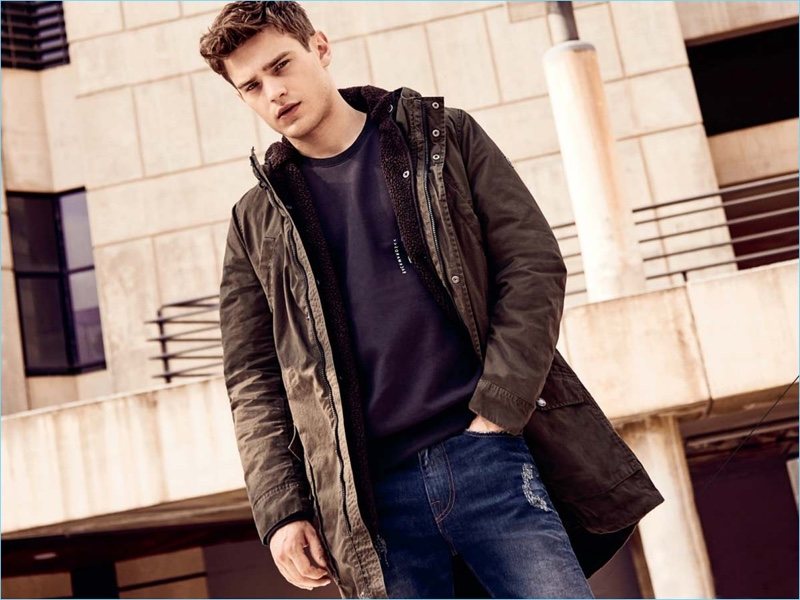 Sporting a parka, Bo Develius appears in Q/S designed by s.Oliver's fall-winter 2018 campaign.