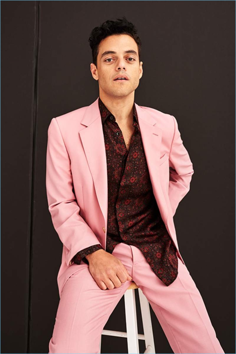 Front and center, Rami Malek dons a pink Alexander McQueen suit with a Saint Laurent printed silk shirt.