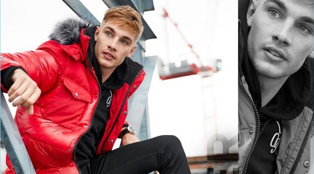 Parka: Tommy Marr sports a red faux fur trim hooded long puffer jacket by River Island.