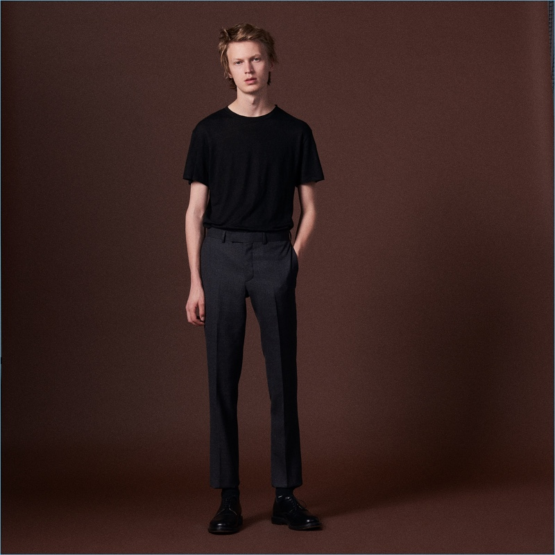 Jonas Glöer sports a tailored pair of wool suit trousers by Sandro.