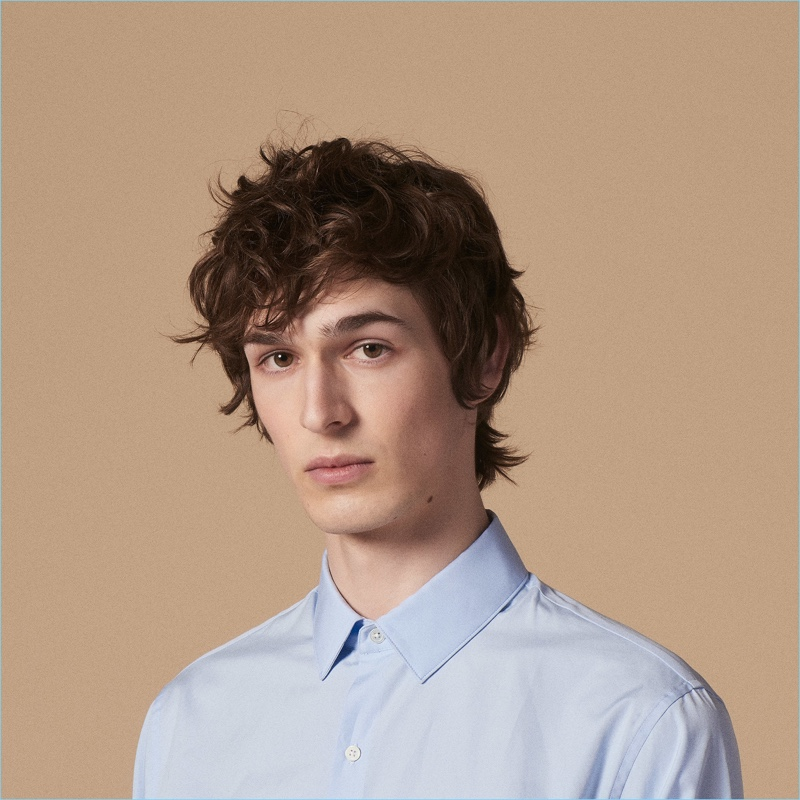 Dylan Fender wears a slim-fit shirt in stretch cotton by Sandro.