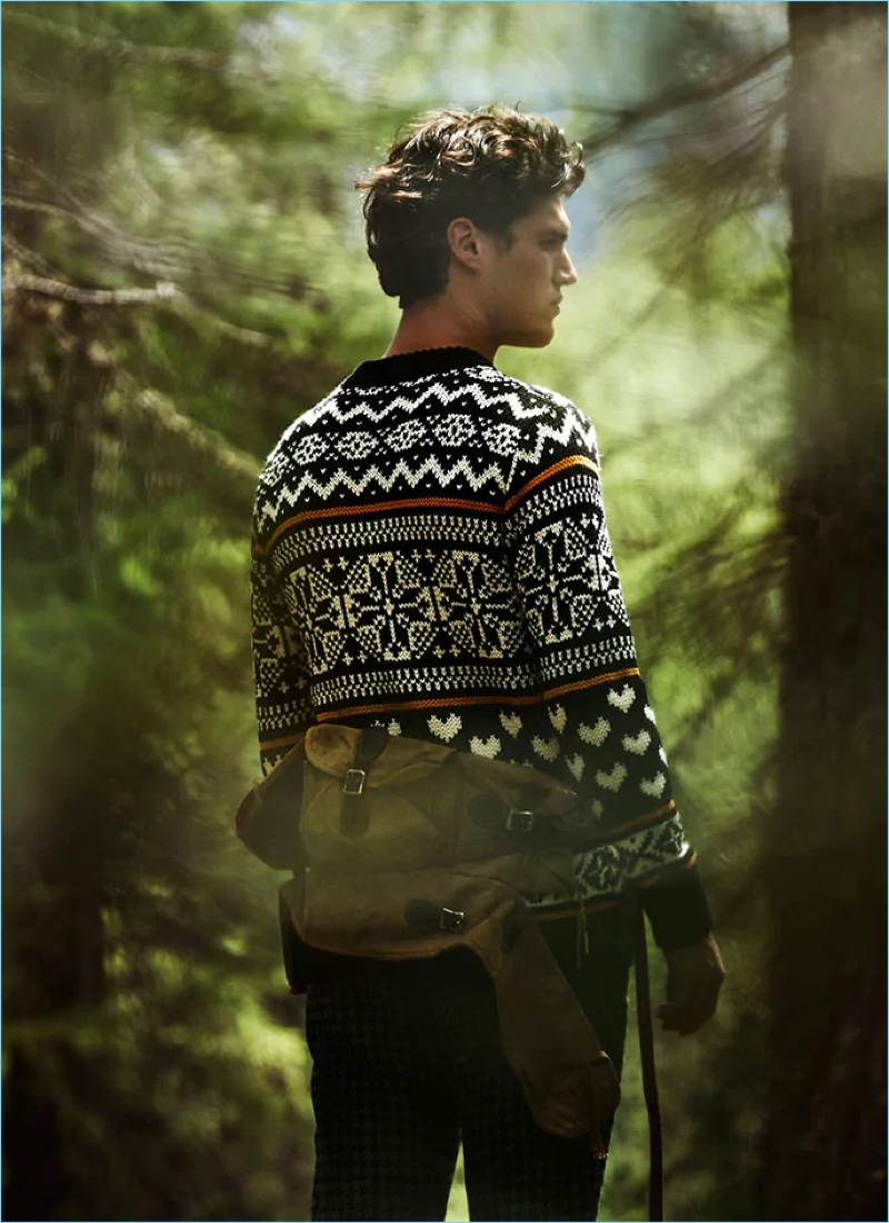 Mixing patterns, Benjamin Reynier wears a fair isle sweater and checked trousers for Scotch & Soda's fall-winter 2018 campaign.