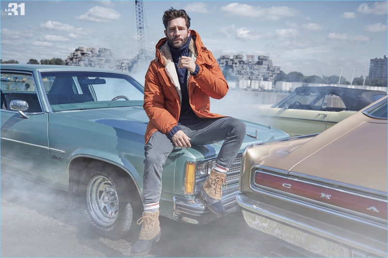 Embracing a rugged ease, John Halls sports a Holubar parka, LE 31 turtleneck sweater, and Sorel boots.