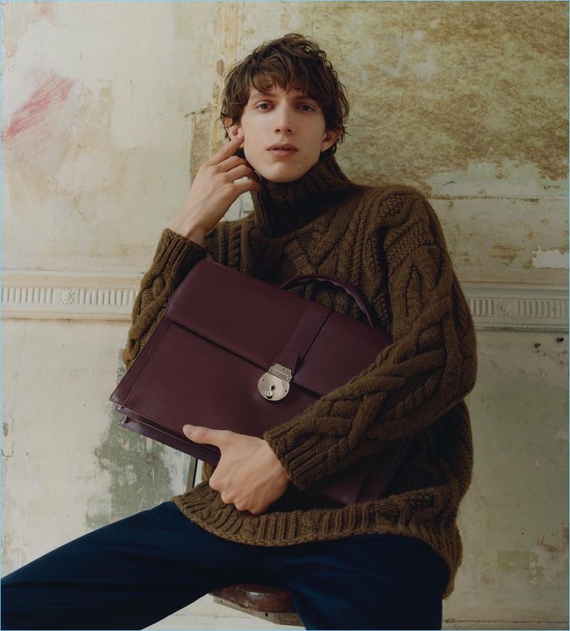 Xavier Buestel takes hold of Smythson's oxblood-colored briefcase for the brand's fall-winter 2018 campaign.